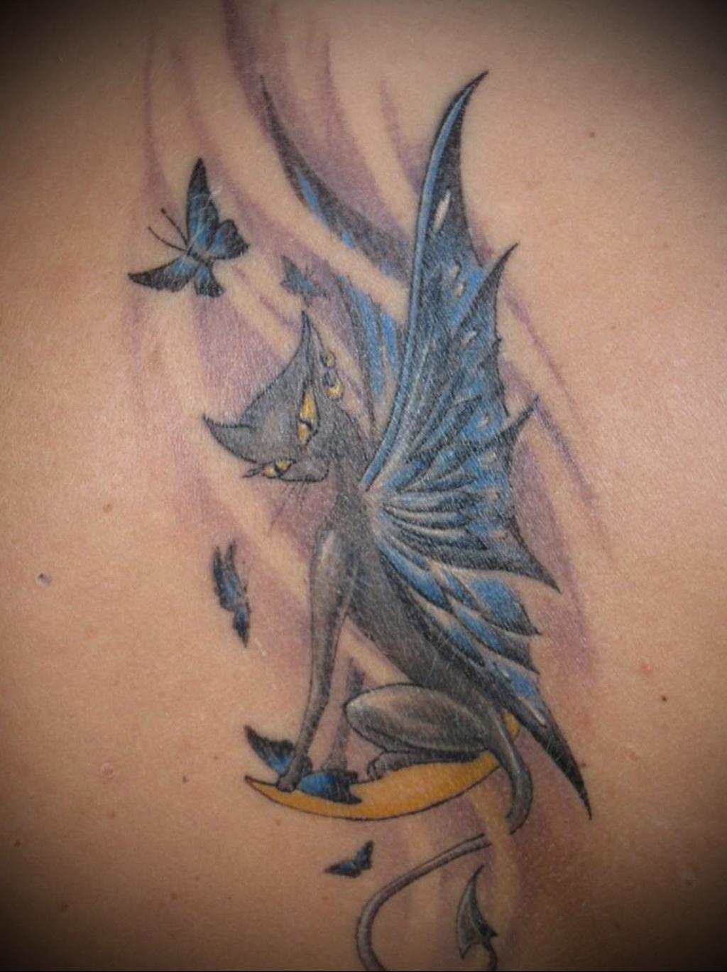 Значение татуировки кошка 7
