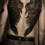 Значение татуировки крылья на спине 7