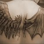 Значение татуировки крылья на спине 8