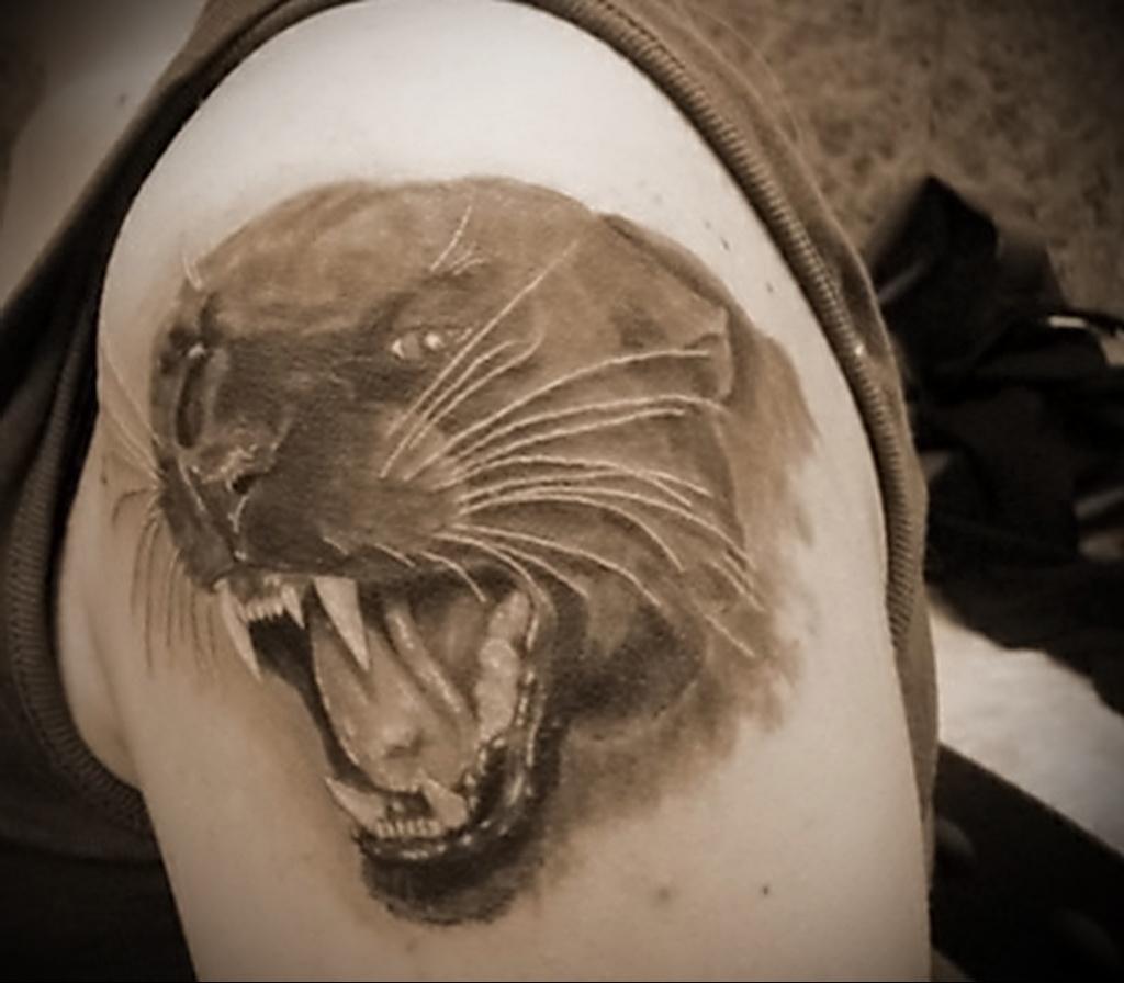 Значение татуировки пантера 6
