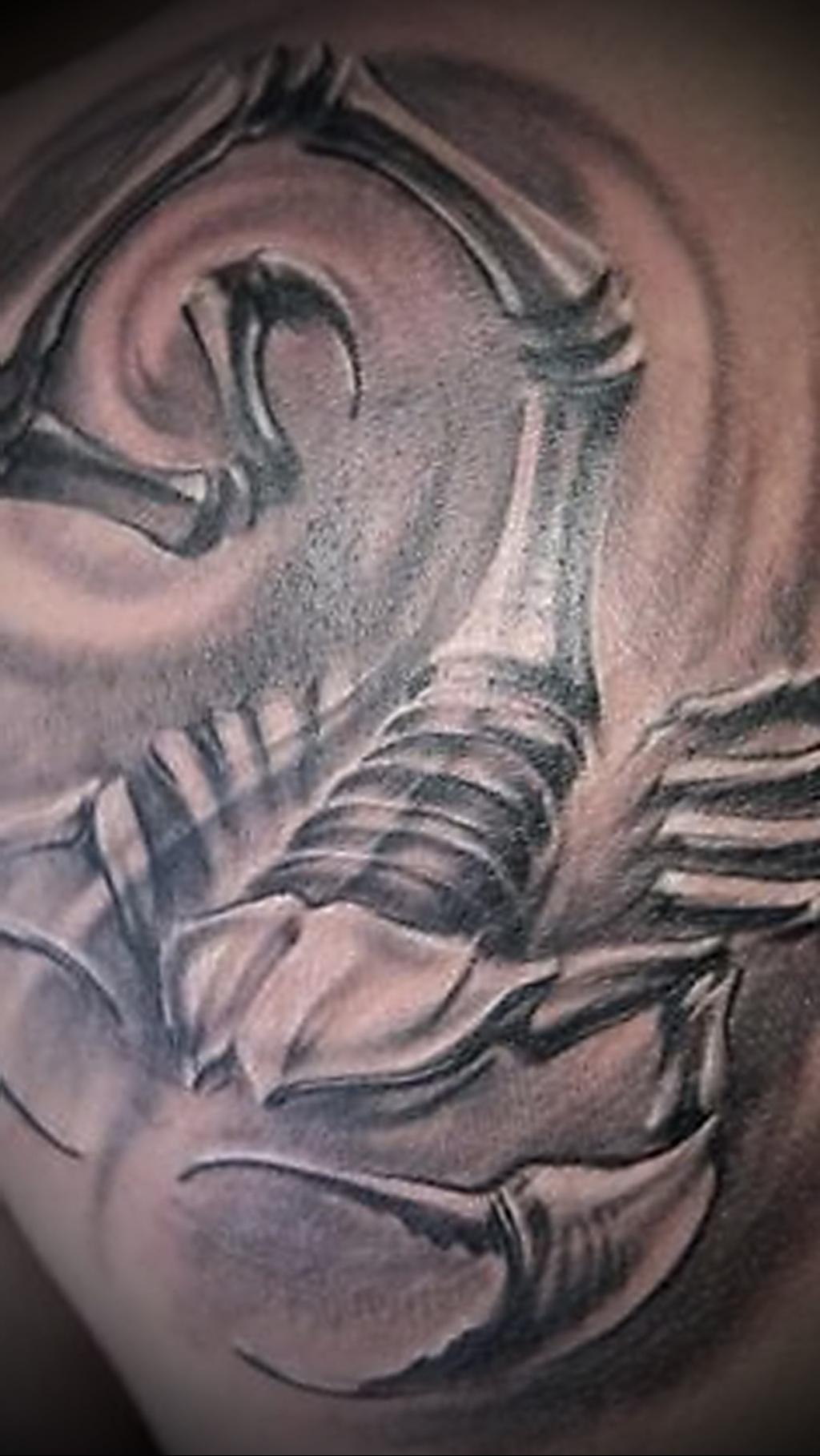 Значение татуировки скорпион 9