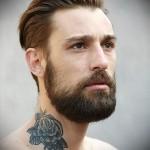 бородатый парень с тату роза - татуировка на шее мужчины - фото