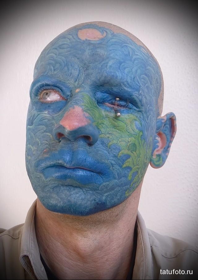 все лицо в тату голубого цвета