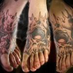 демонический череп - татуировка на стопе мужская - фото