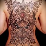 картина узорами тату на спине женская
