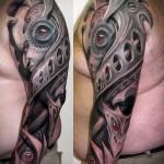 классная биомеханика в тату - мужская татуировка на плече