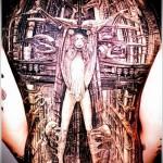 космическая идея с девушкой - тату мужская на спине фото