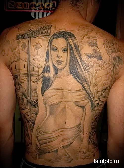 красивая девушка со стройным телом - тату мужская на спине фото