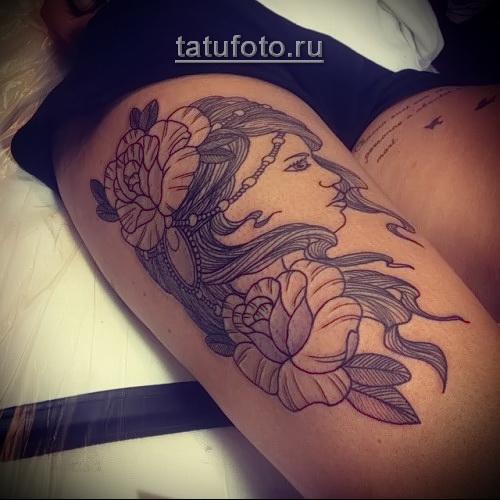 крупная татуировка с лицом девушки на ногу - стиль олд скул