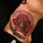 крысный цветок с ареолом - татуировка на шее мужчины - фото