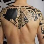 маори картина - тату мужская на спине фото