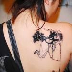 медуза горгона тату на спине женская