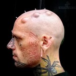 паук в паутине - татуировка на шее мужчины - фото
