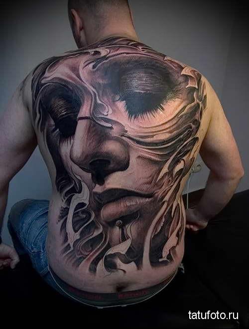 портрет красивой девушки татуировка на спине мужская фото