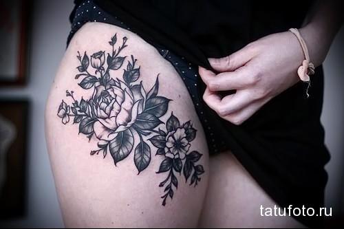 разные цветы в татуировке на ногу для девушки