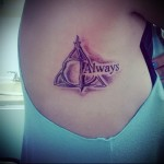 символ и надпись - ВСЕГДА - женская татуировка на боку