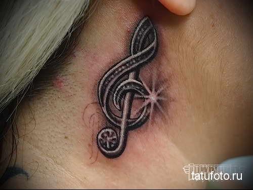 скрипичный ключик и блеск - татуировка на шее женская - фото