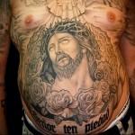 тату внизу живота мужчины - иисус
