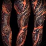 тату крутая биомеханика на руку - - мужская татуировка на плече