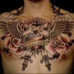 тату - крылья, розы, часы, оружие - ячркие цвета - мужская татуировка на грудь