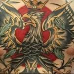 тату орел в короне - мужская татуировка на грудь