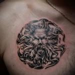 тату портрет мужчины в славянском символе - мужская татуировка на грудь