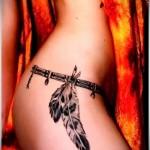 тату пояс с перьями на талию - татуировка на пояснице женская фото