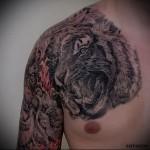 тату реализм - оскал тигра - мужская татуировка на грудь