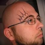 тату символы над глазом