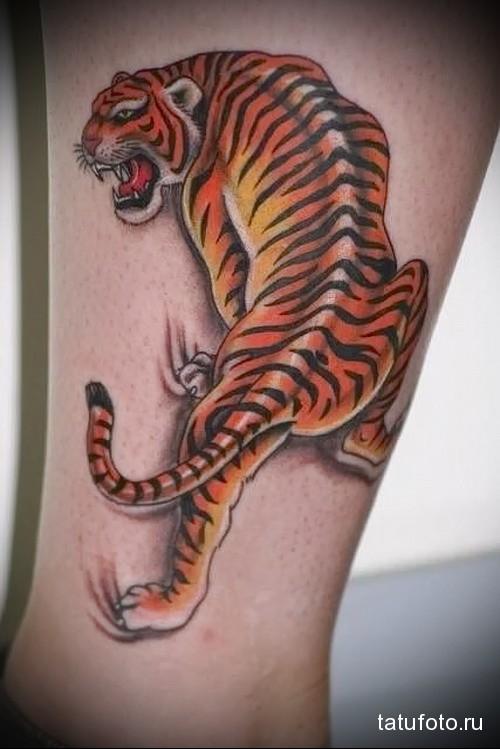 татуировки фото мужские на ноге