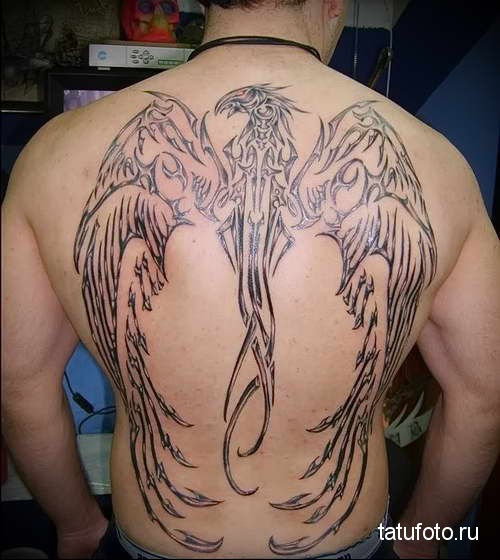 феникс в форме клинка - татуировка на спине мужская фото