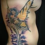 фея в маске - женская татуировка на боку