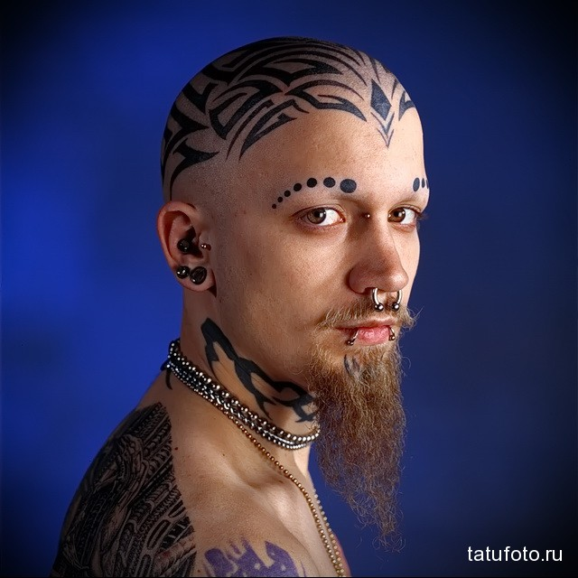 Man with Face Tattoos and piercings