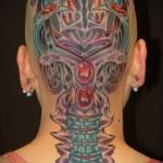 цветная женская тату на голове в стиле биомеханика