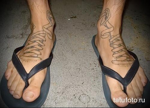 тату мужское на ноге фото