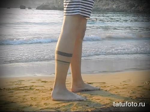 блекворк линии-браслеты татуировка на ноге мужская