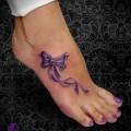 пример женской тату на стопу (низ ноги) 2