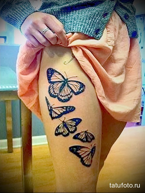 татуировка бабочки в полете на ногу для девушки