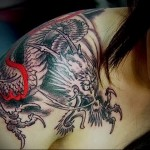 Dragon tattoo on shoulder blade