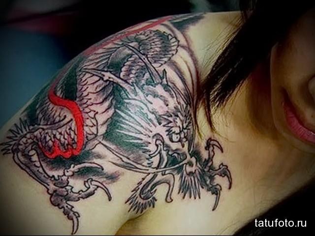 Dragon tattoo on shoulder blade