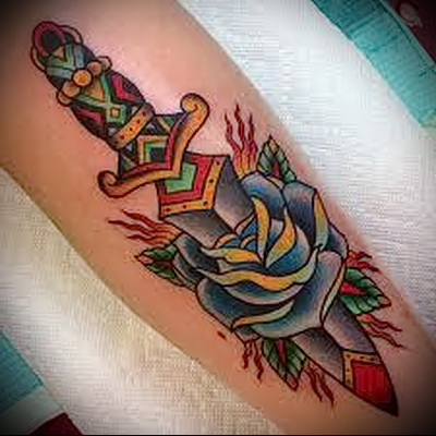 rose and dagger tattoo