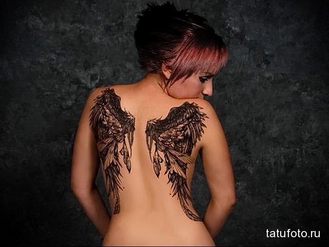 tattoo wings on the blades