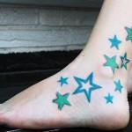 татуировка голубые звезды внизу ноги