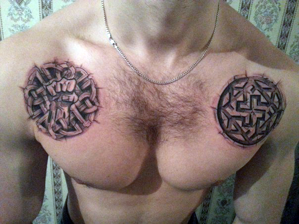 Два символа в мужской славянской татуировке на груди