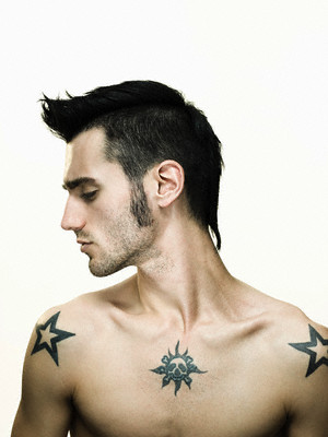 Man with tattoos --- Image by © Image Source/Corbis