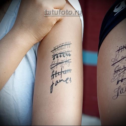 татуировка на руку - зачеркнутые надписи