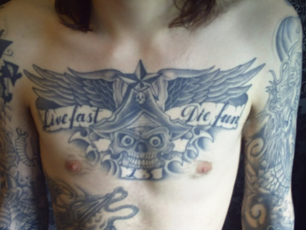 Татуировки на грудной клетке мужские 13