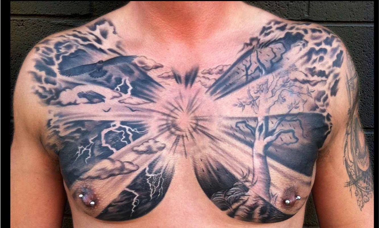 Татуировки на грудной клетке мужские 7