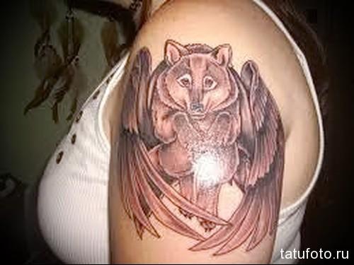 волк с крыльями тату 1