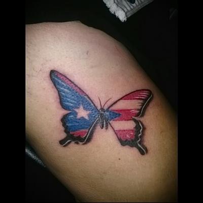 butterfly tattoo on her leg 2